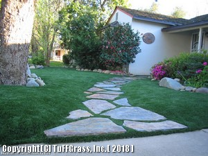 ARTIFICIAL GRASS AND FLAGSTONE PATH